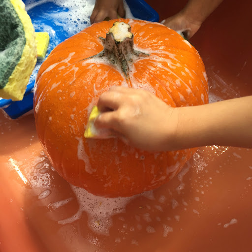 kids painting a pumpkin for acryicl paint